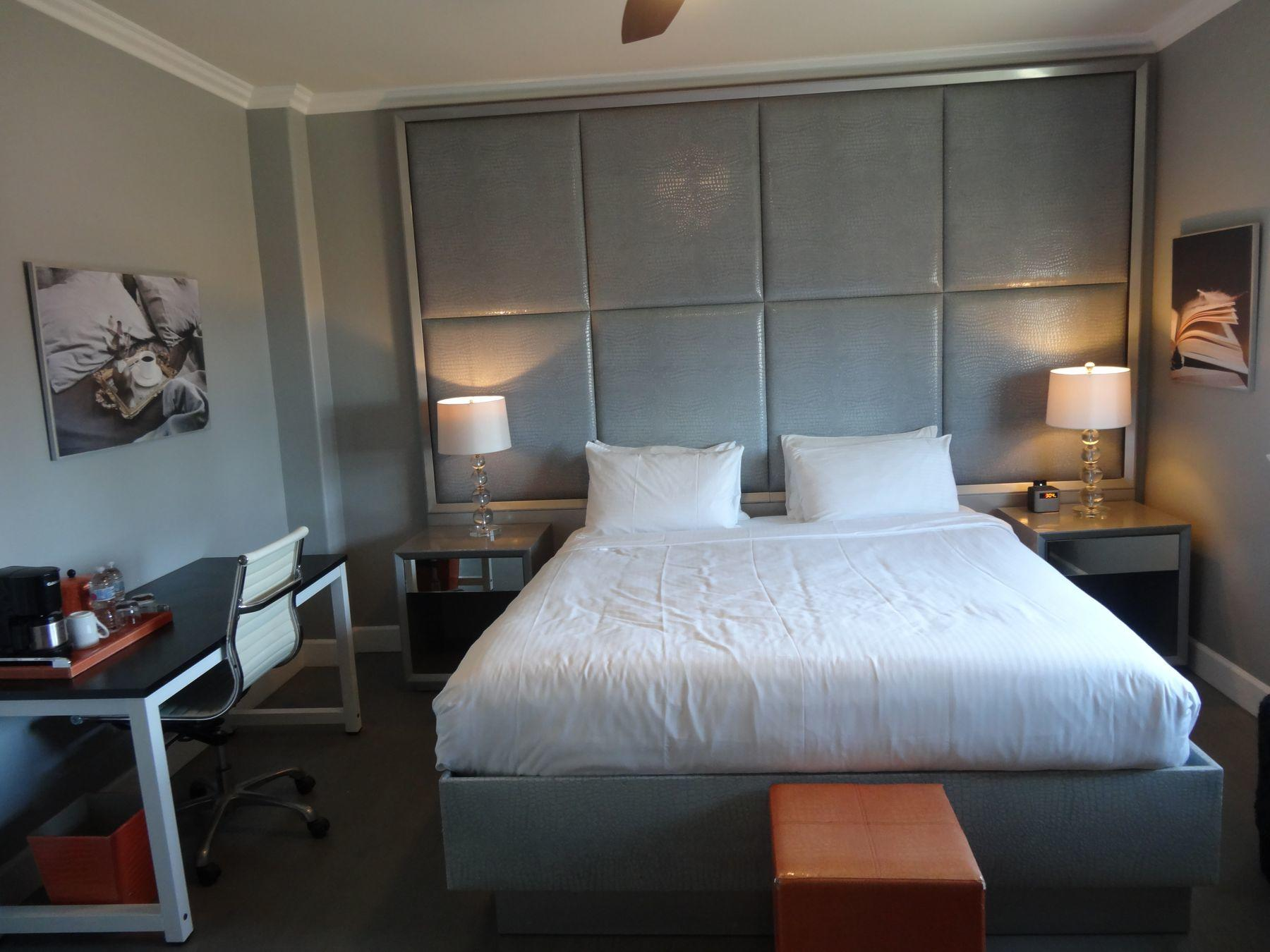 room with grey headboard
