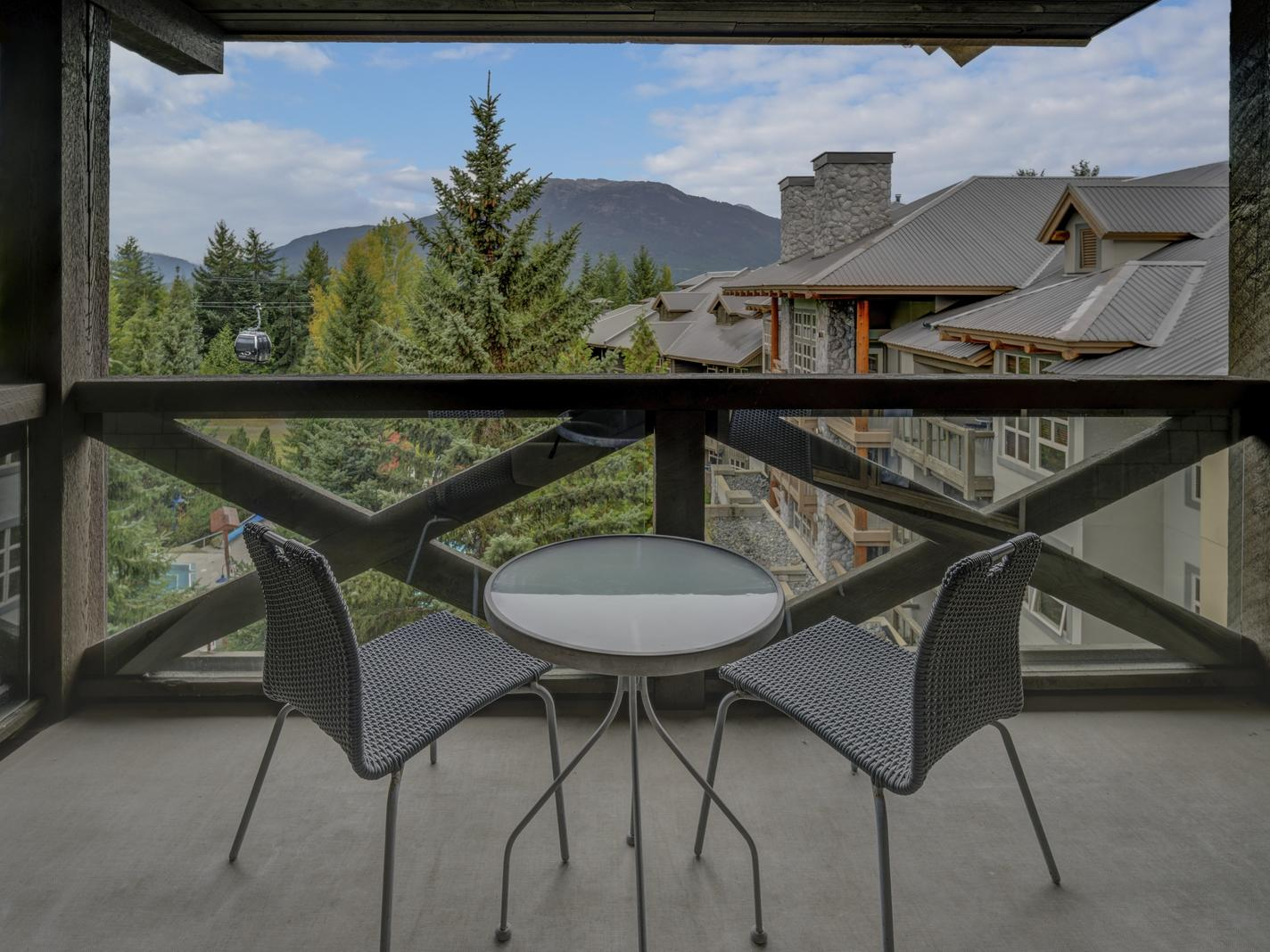 balcony chairs overlooking resort and mountains