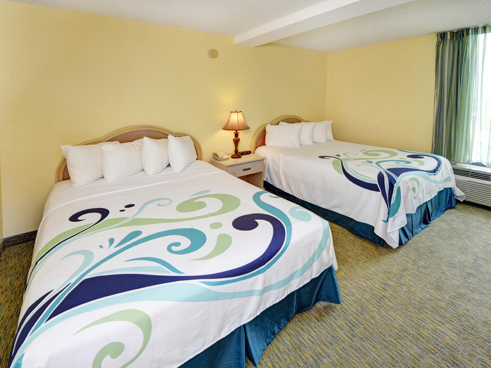 Hotel room with two double beds.