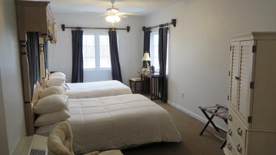 ADA Accessible Room with 2 double beds, small table, and lounge chair