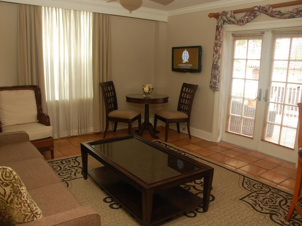 living room area of hotel room with coffee table