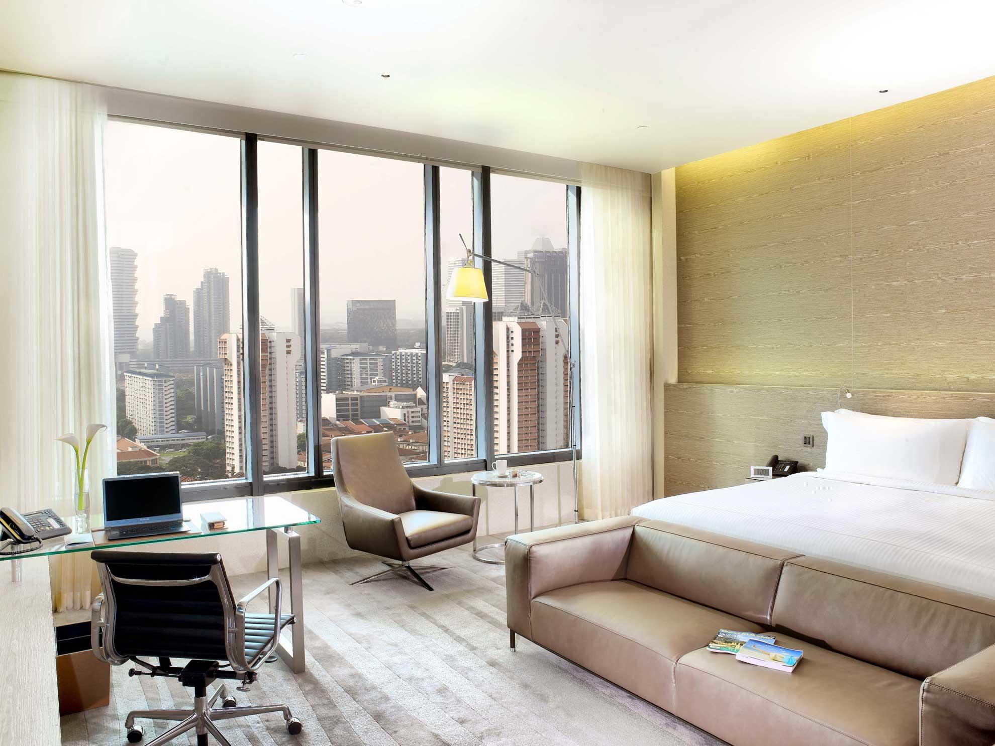 Interior of Skyline studio with a building view at one farrer hotel