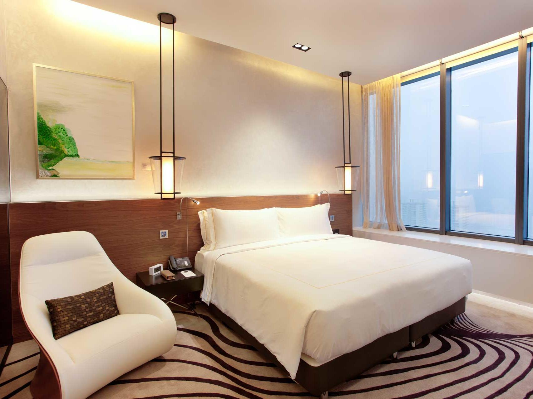 Interior of heliconia standard bedroom at one farrer hotel