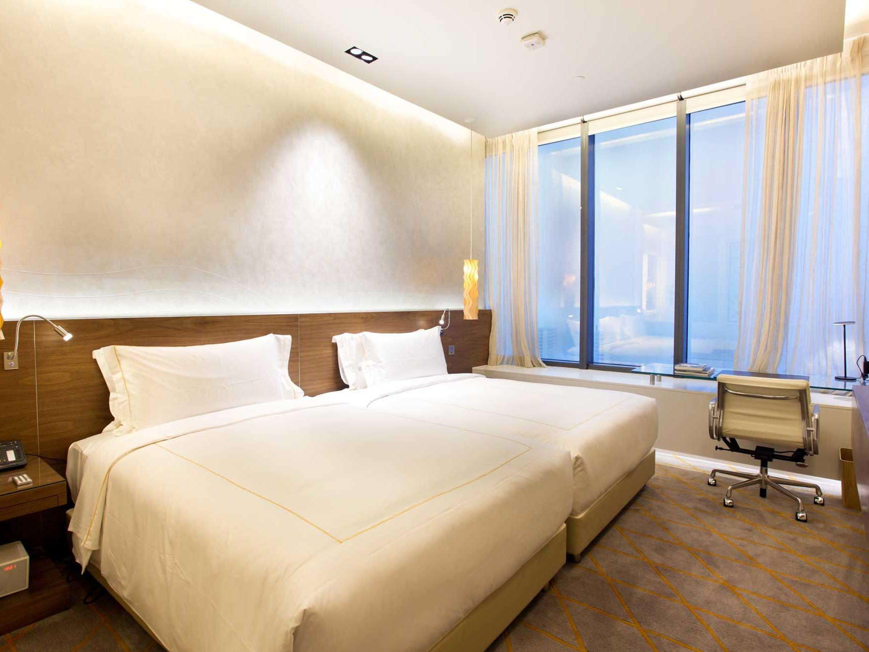 Interior of Jasmine standard bedroom at one farrer hotel