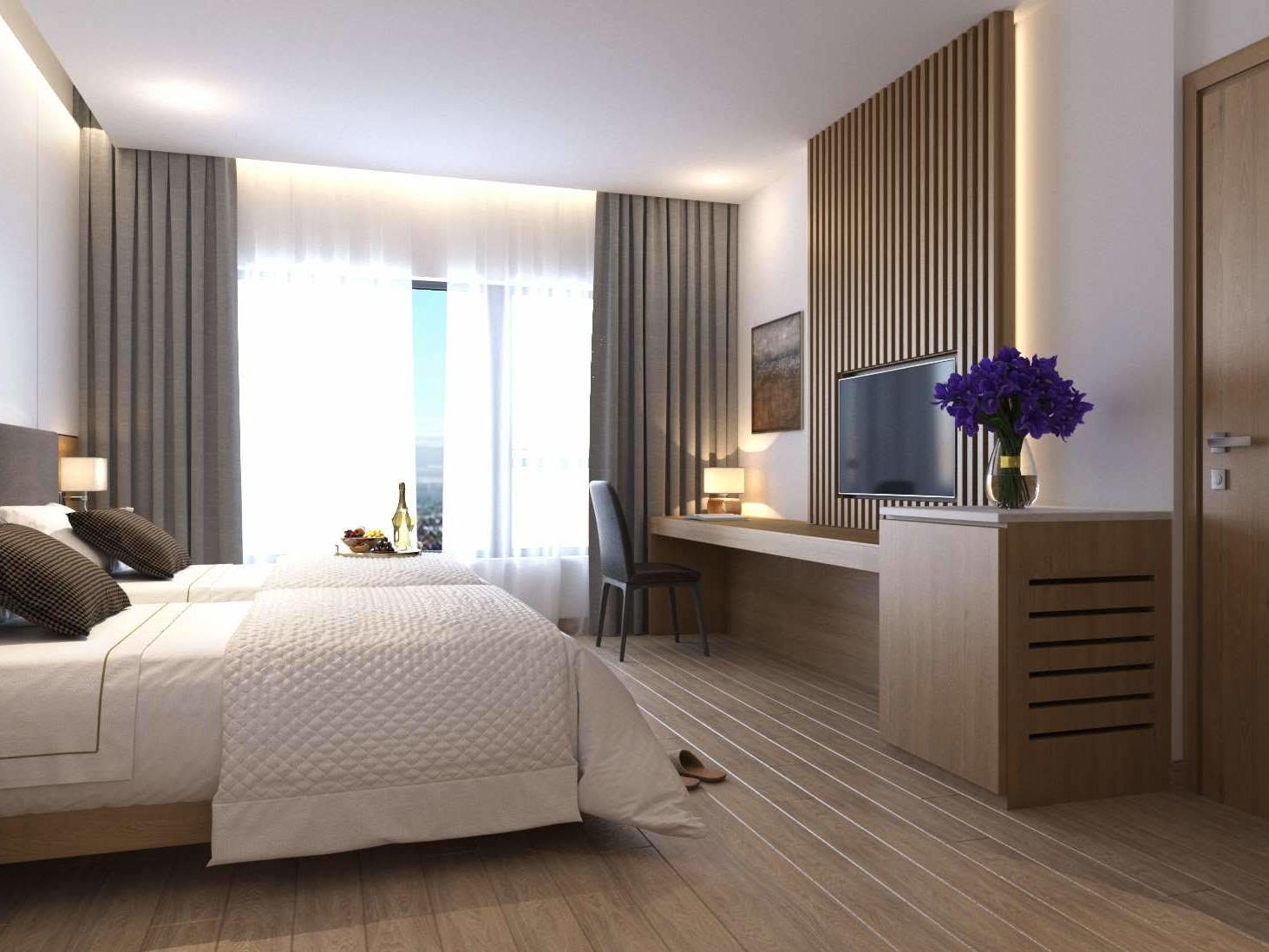 hotel room interior with twin bed, contemporary furnishings and television