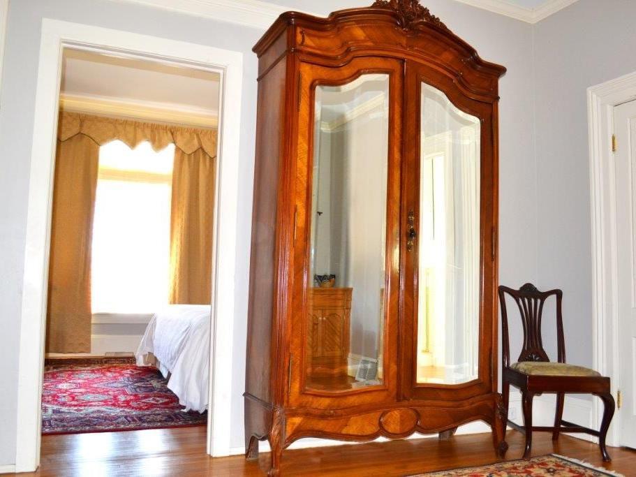 antique dresser with mirrored doors