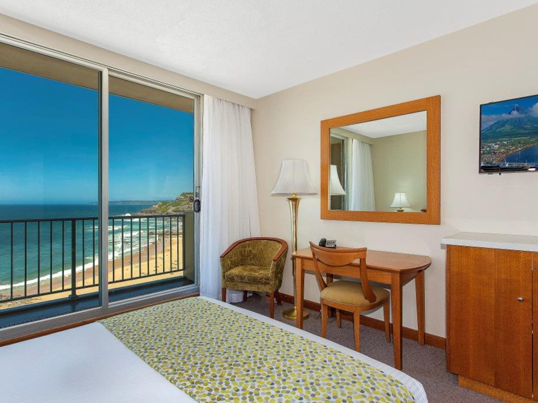 hotel room with balcony and vanity area