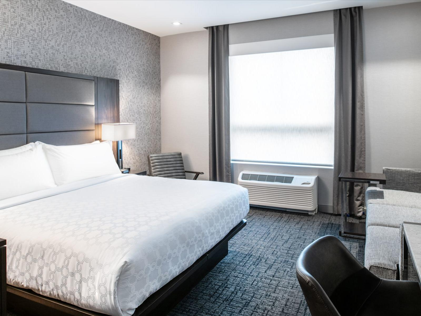 king bed in modern hotel room with window