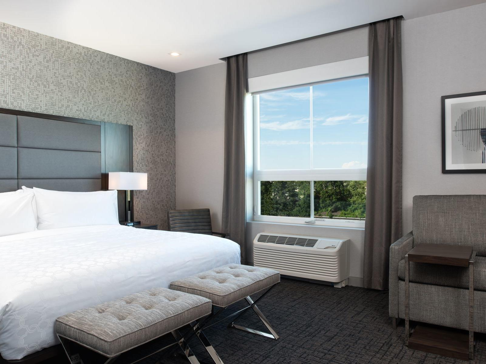 king bed next to window in modern hotel room