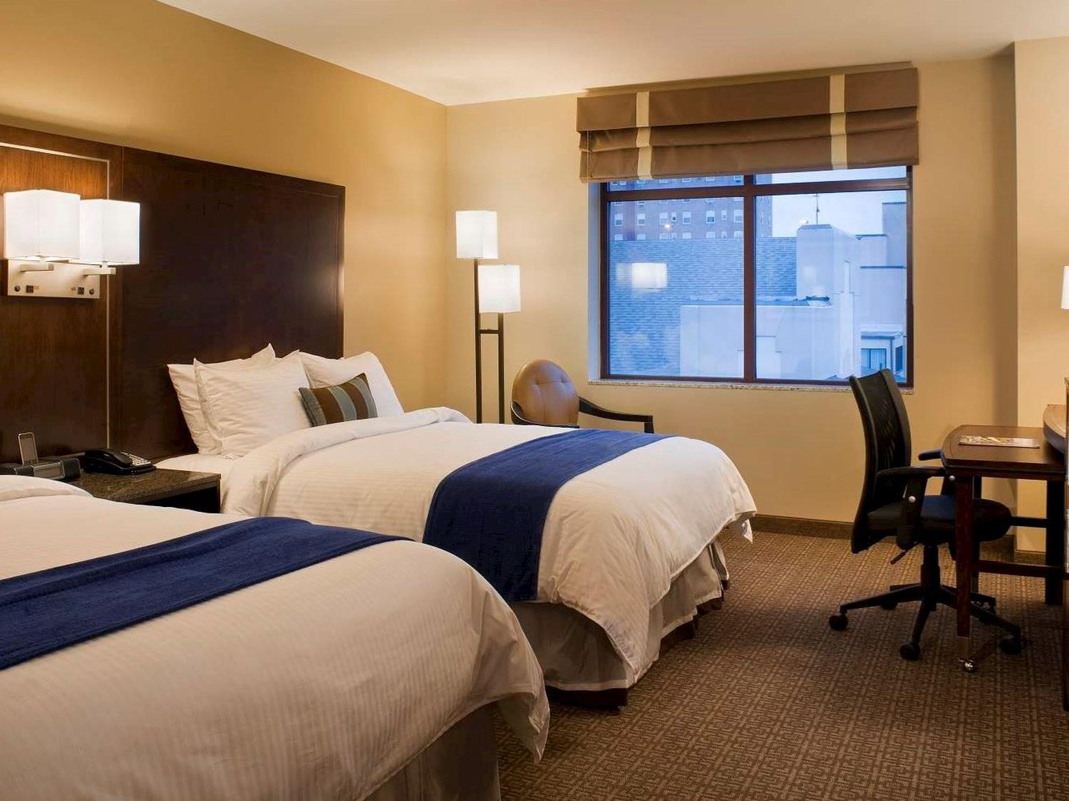 Double Queen Guestroom Interior with downtown views