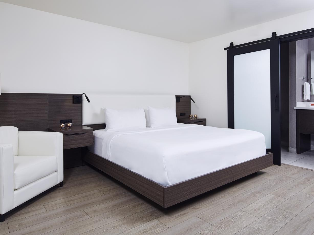 a bed and chair in a hotel room