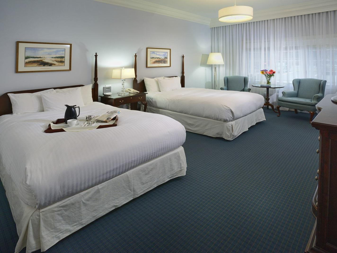 Twin beds in Luxury Two Double at Avon Old Farms Hotel