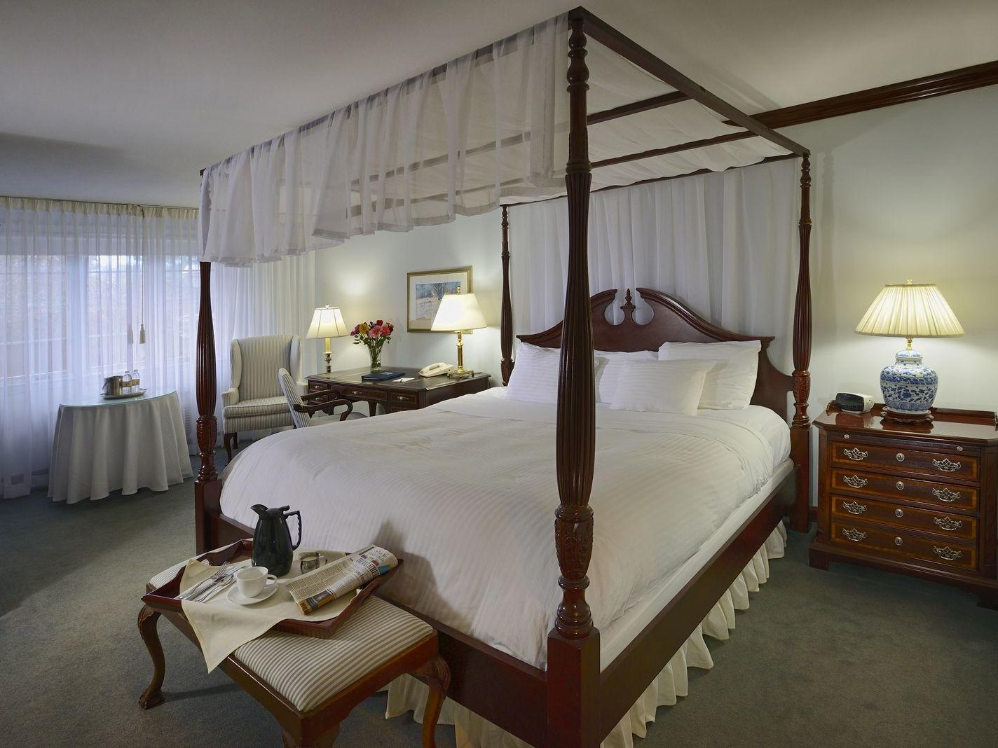 View of Traditional King with king bed at Avon Old Farms Hotel