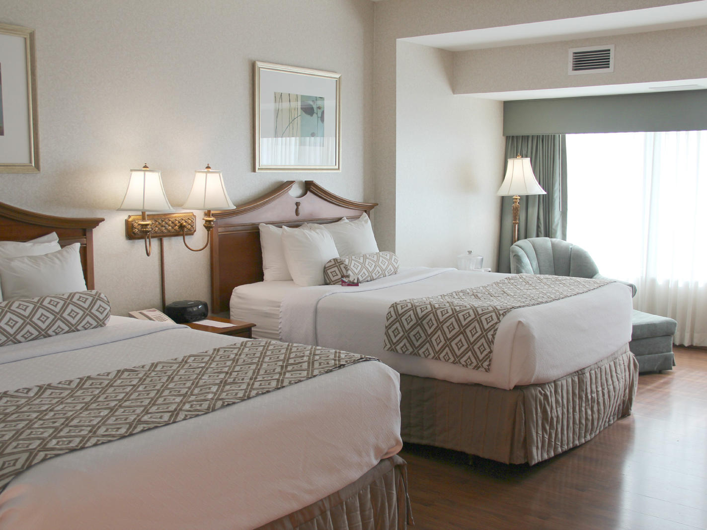 beds in a spacious hotel room