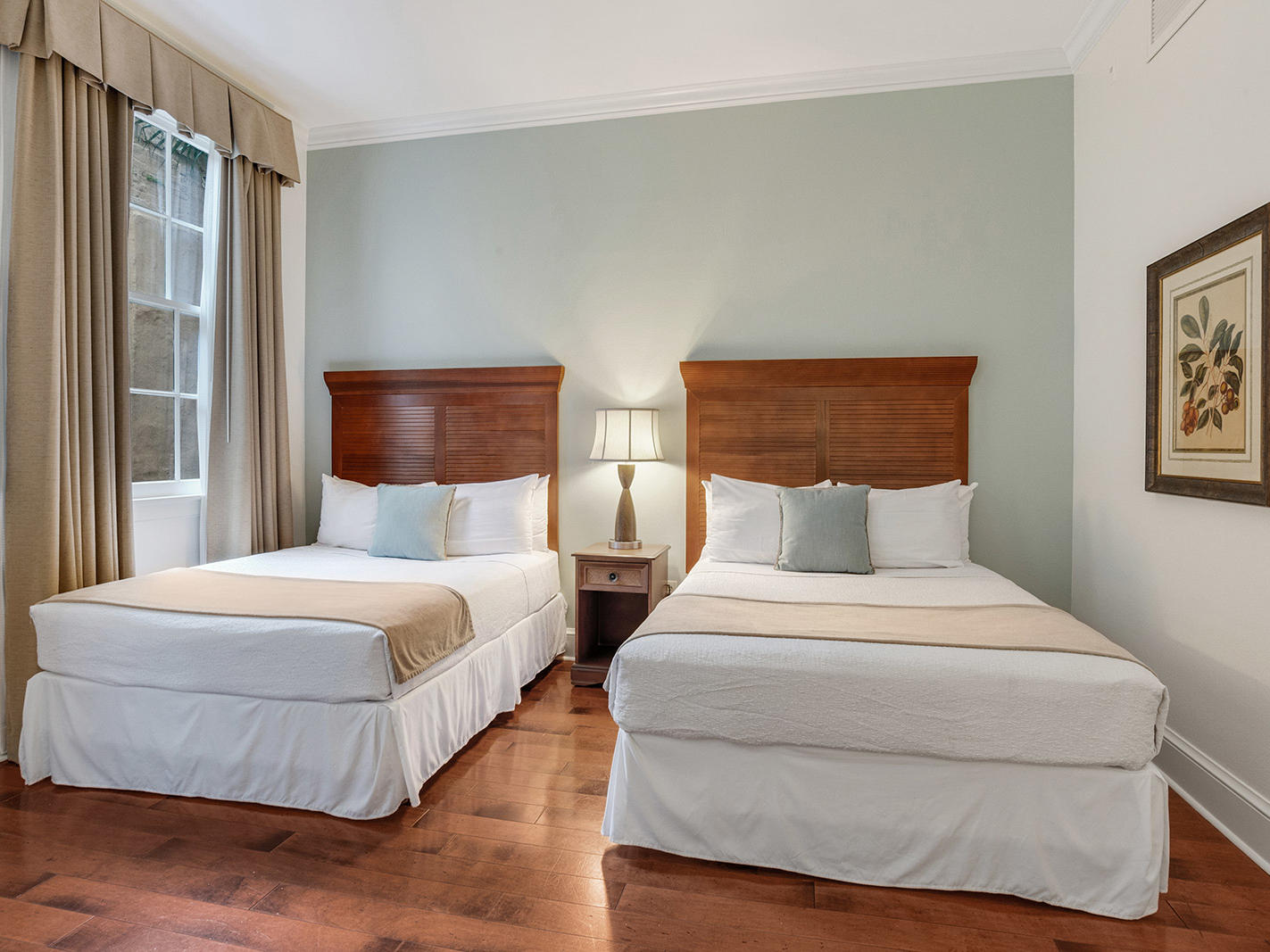 Traditional Two Queen Bed Room with two beds at St. James Hotel