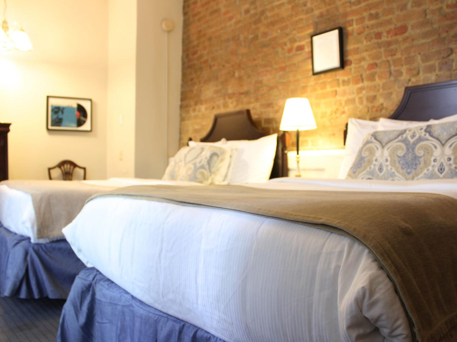 Classic Two Queen Beds Room with two beds at Hotel St. Pierre
