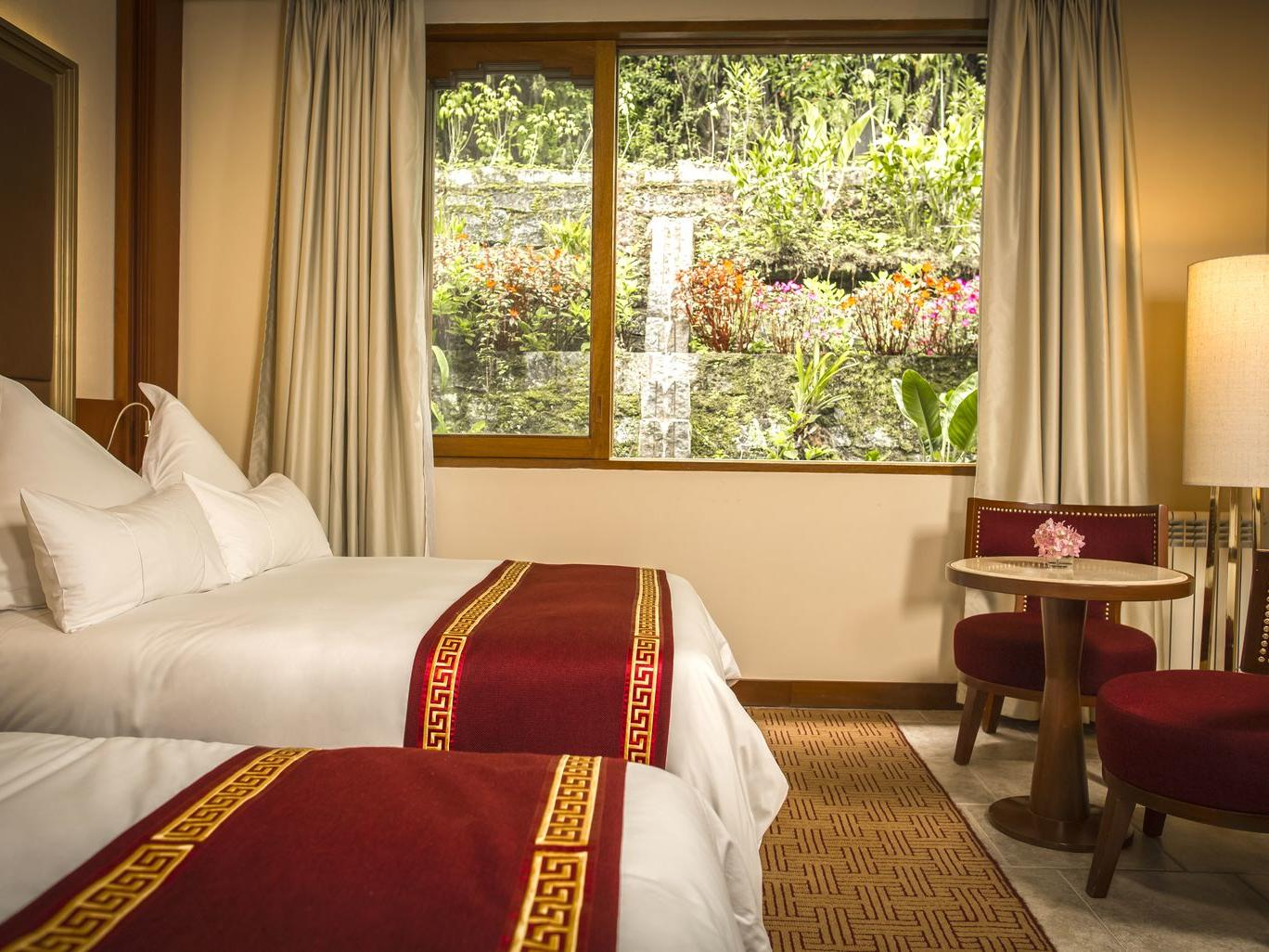 Double beds in Sumaq Deluxe with garden view at Hotel Sumaq