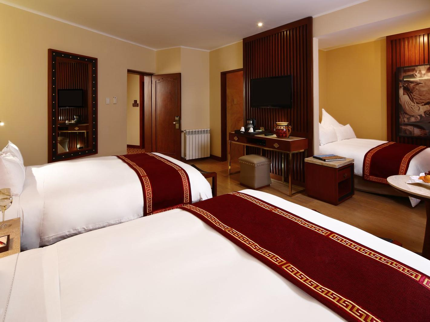 Sumaq Deluxe family room with three beds at Hotel Sumaq