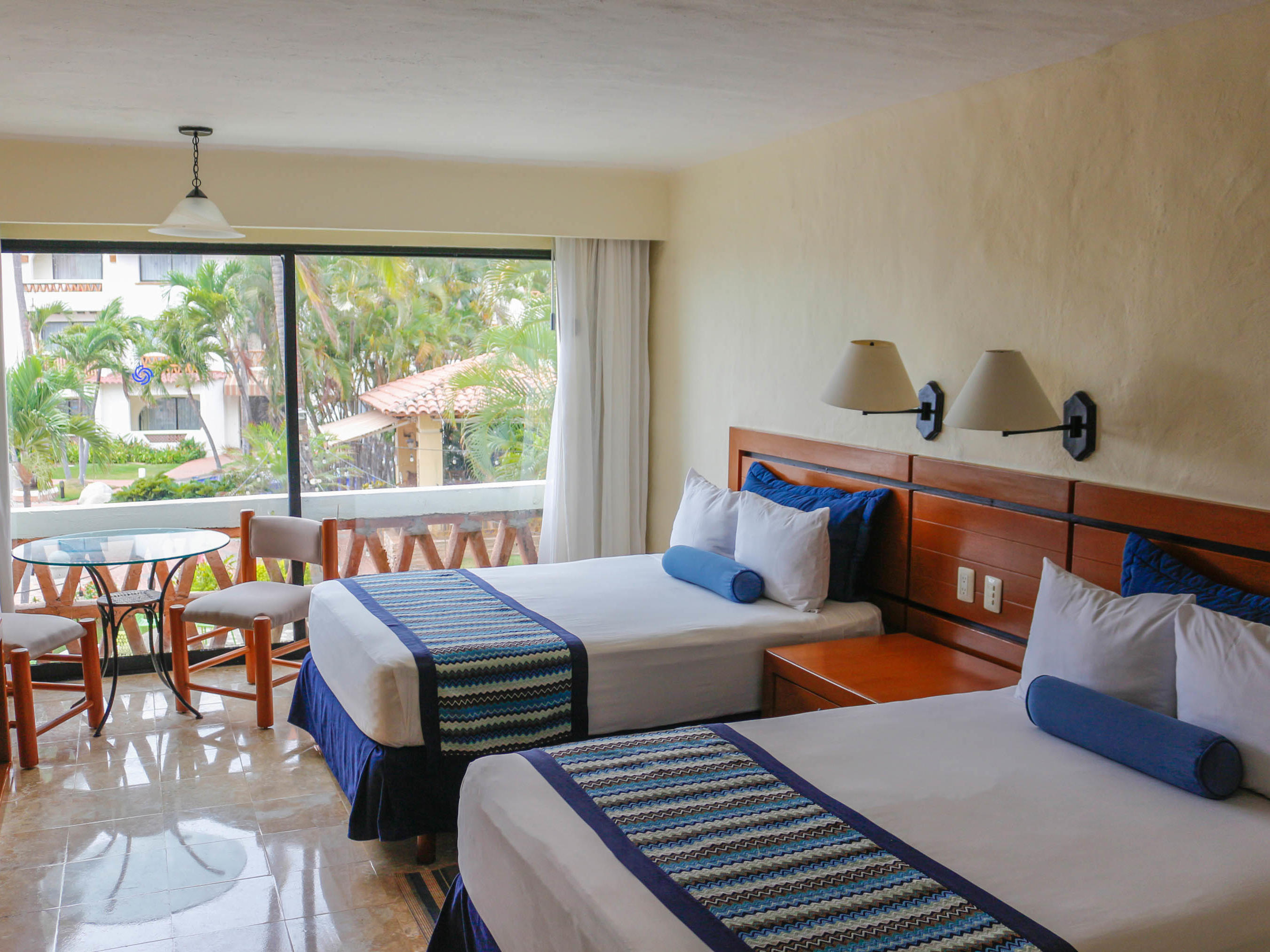 Double Bed Room at Plaza Pelicanos Grand Beach Resort Hotel