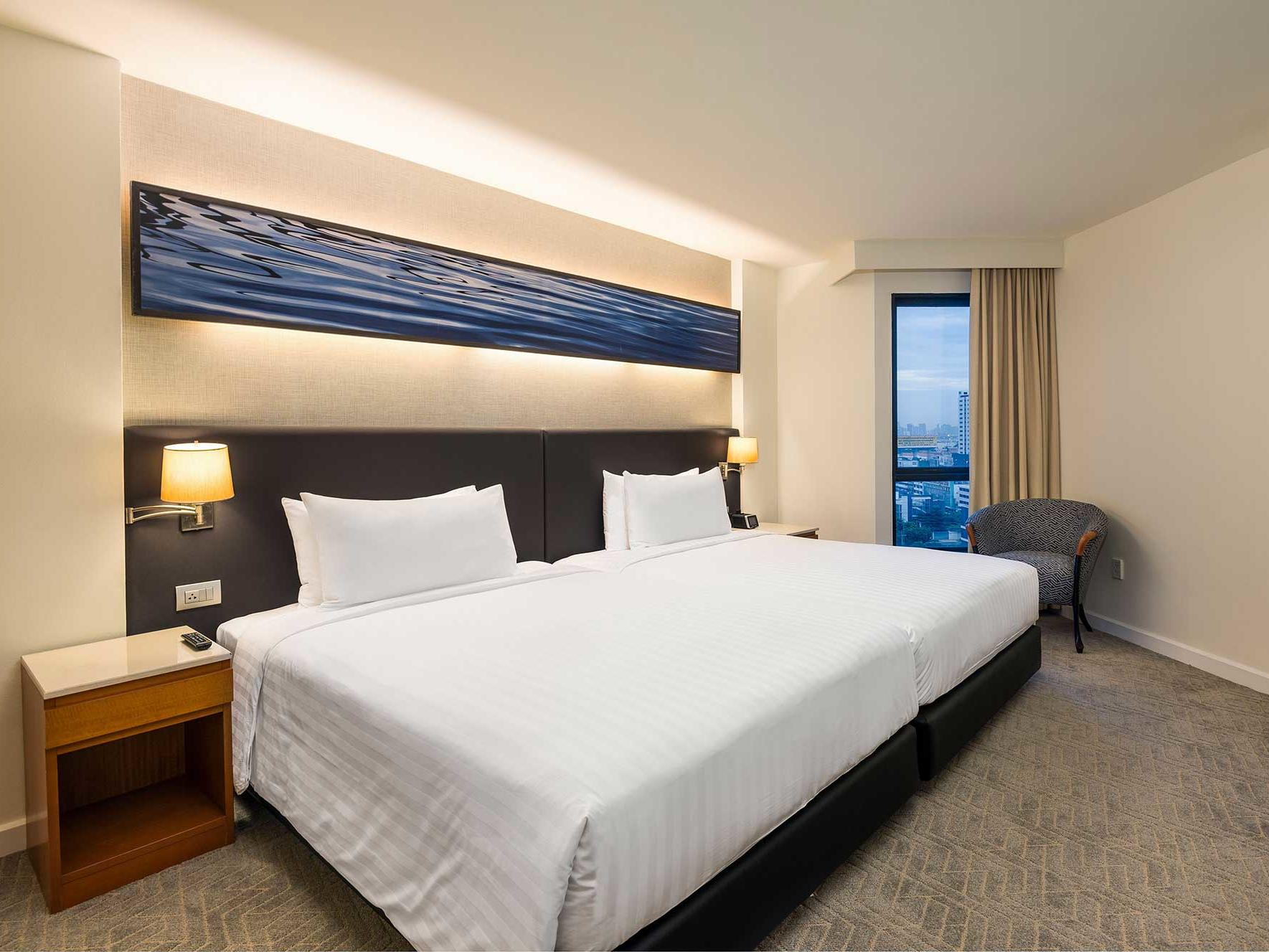 Grand deluxe two bedroom suite at Chatrium Residence Sathon