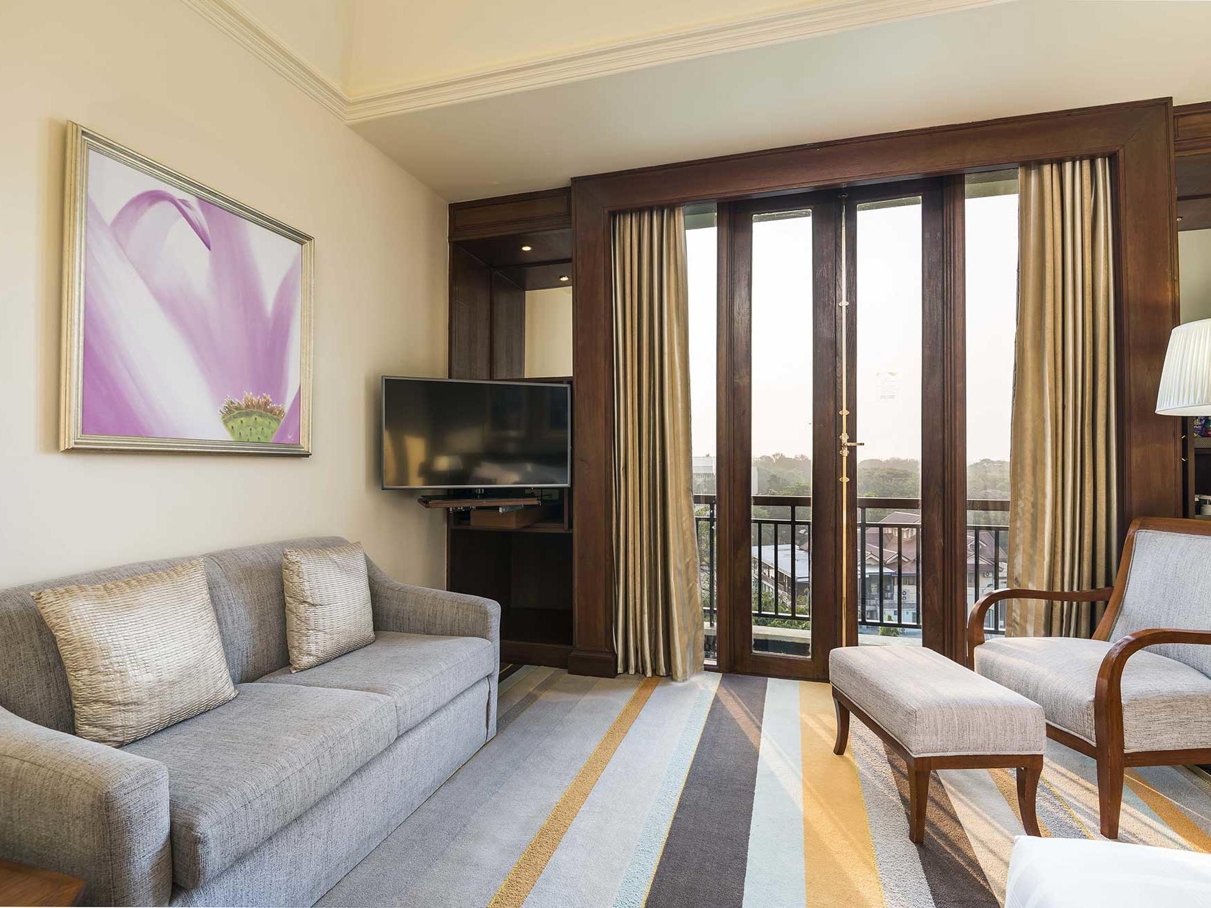 Grand deluxe room city view at Chatrium Hotel Royal Lake Yangon