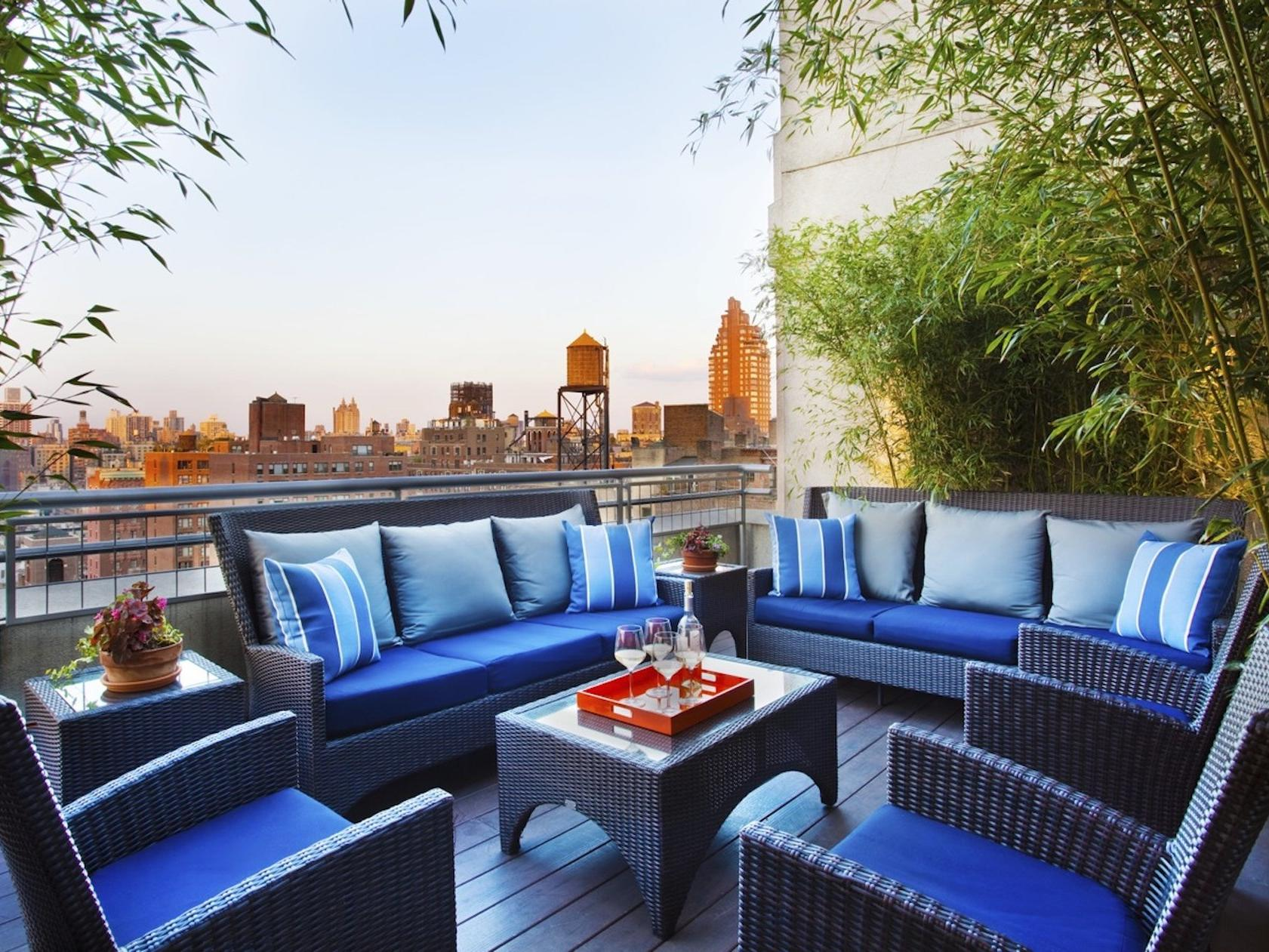 chairs and couches on a rooftop