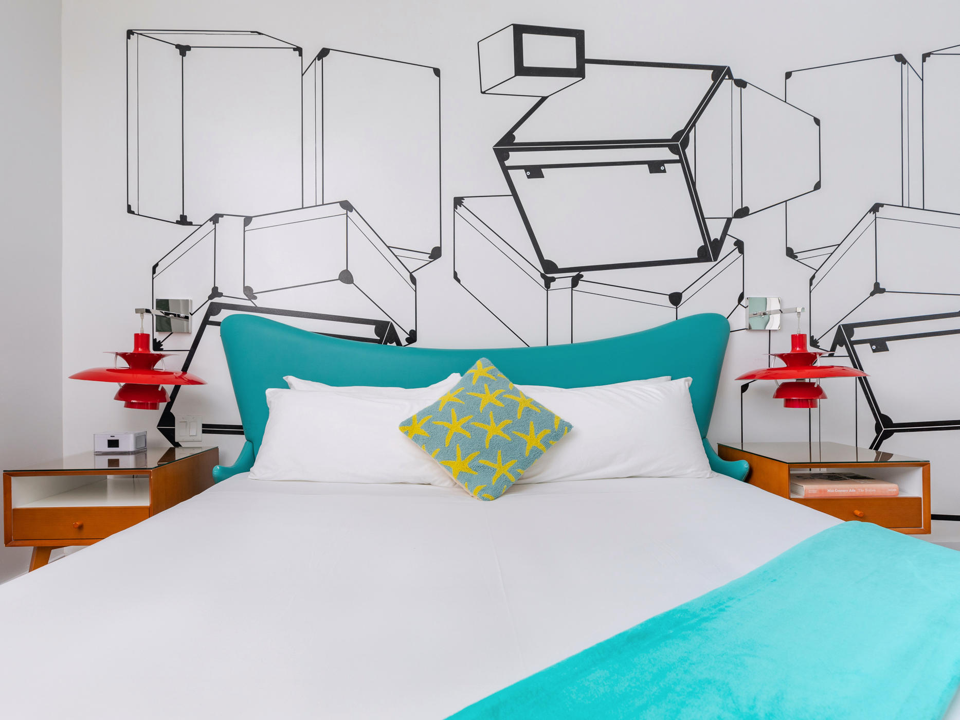 Image of the hand stenciled wall and King size bed in the Galaxy King room