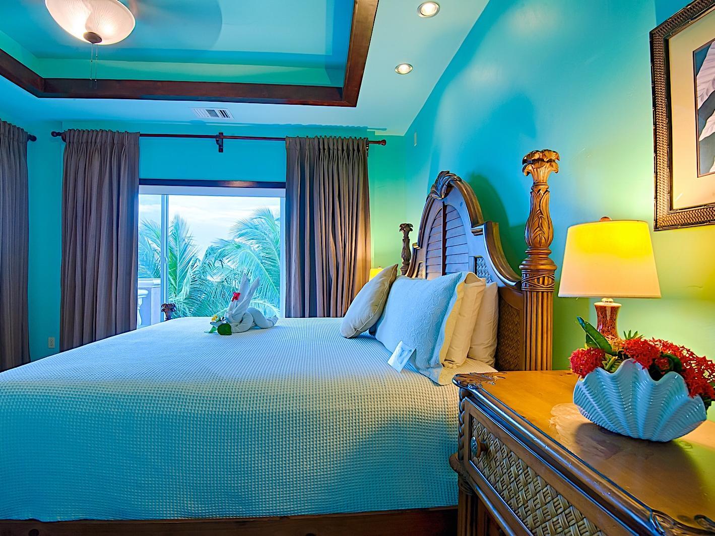 oom with bed, nightstand and door to balcony