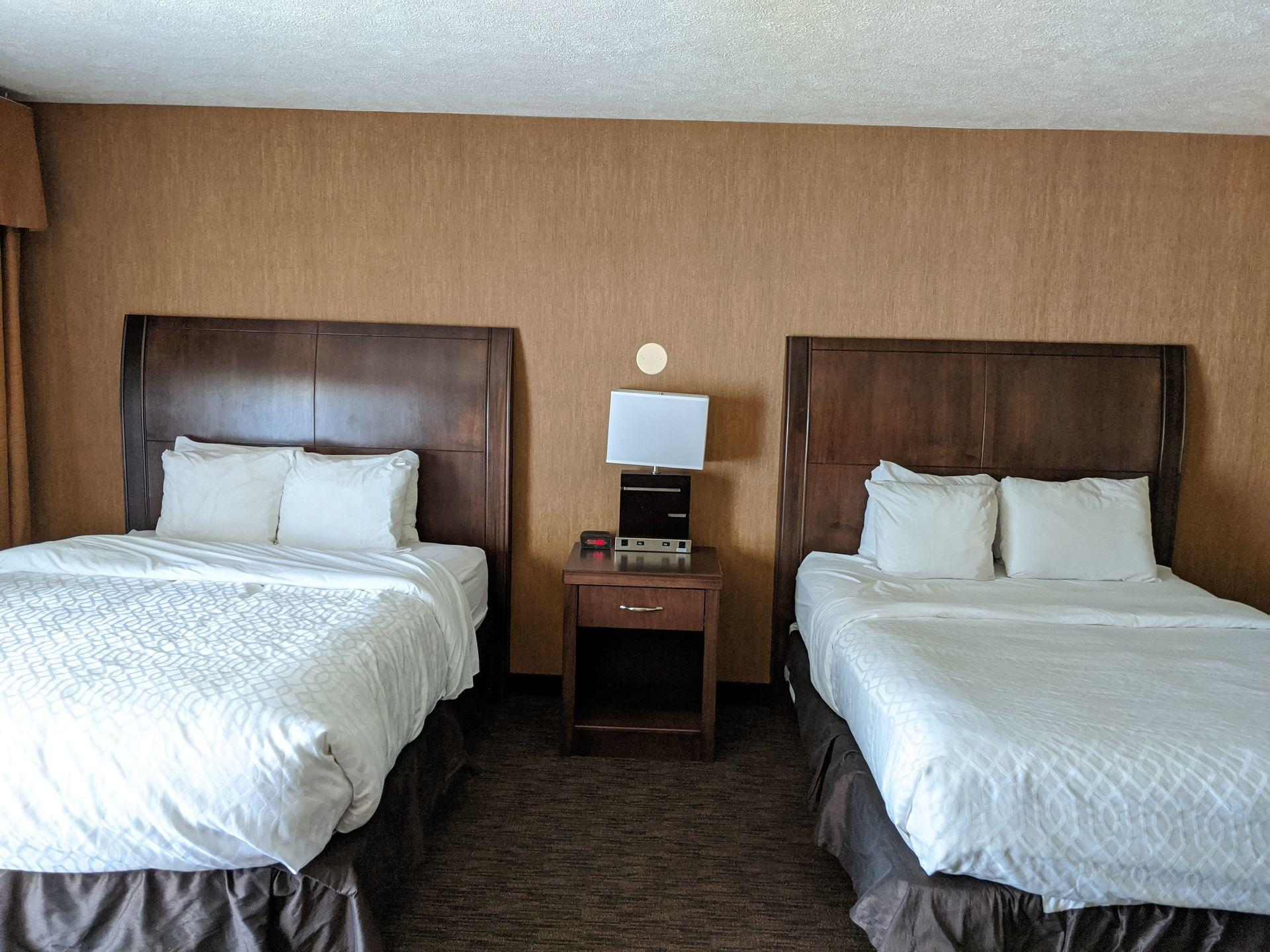room with two beds and nightstand