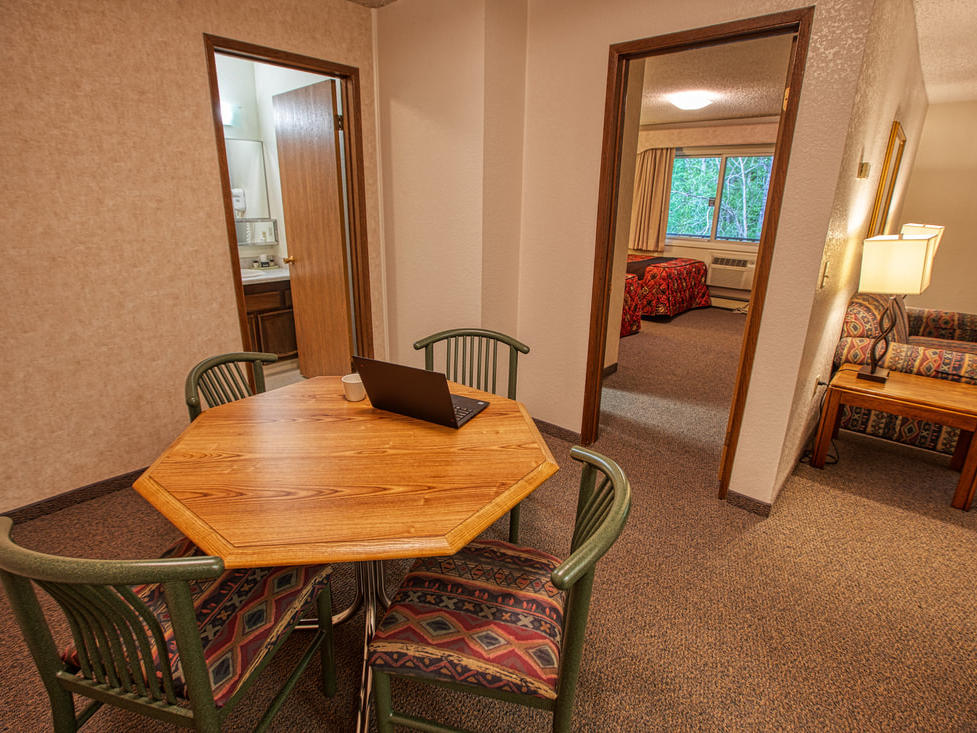 The Luxury two bedroom suite dining area at Wedgewood Resort