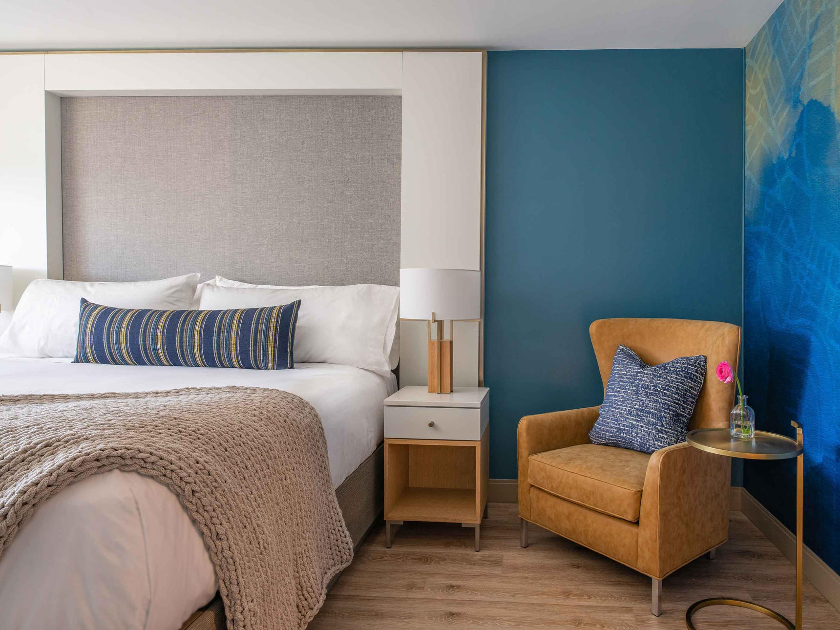 hotel room with bed and sofa chair