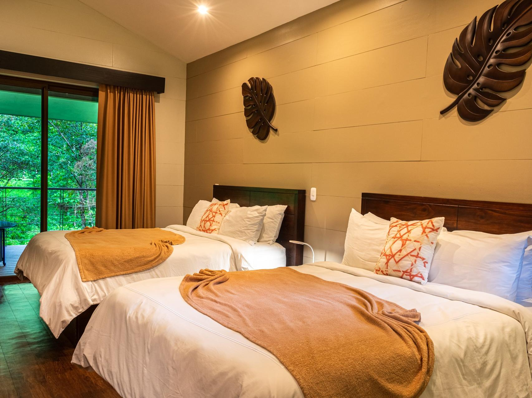 room with two beds and wooden wall art