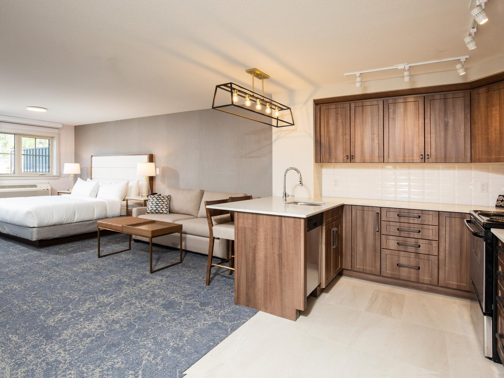 a hotel room with a kitchenette