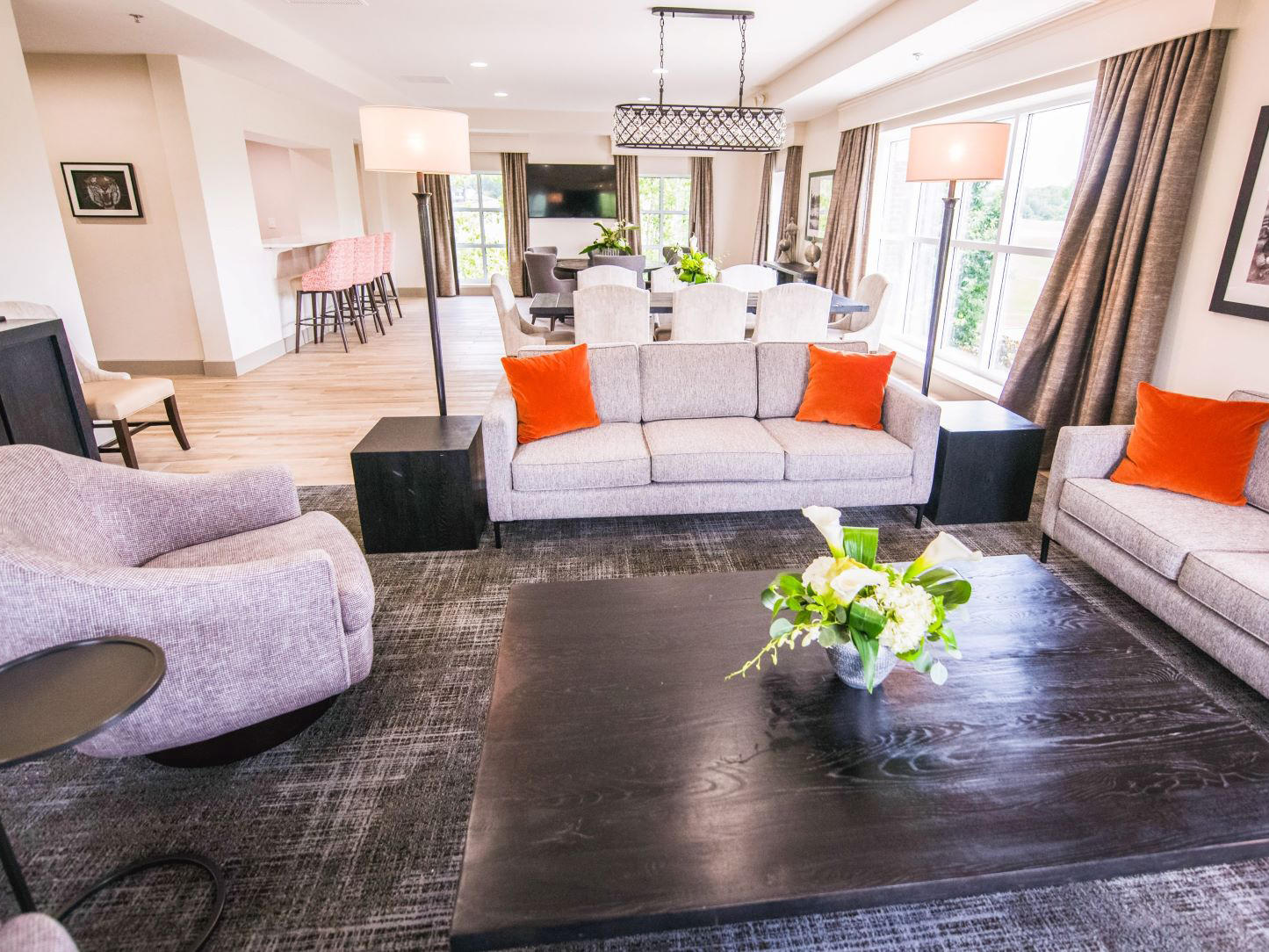 coffee table, couch, and chairs, view of suite
