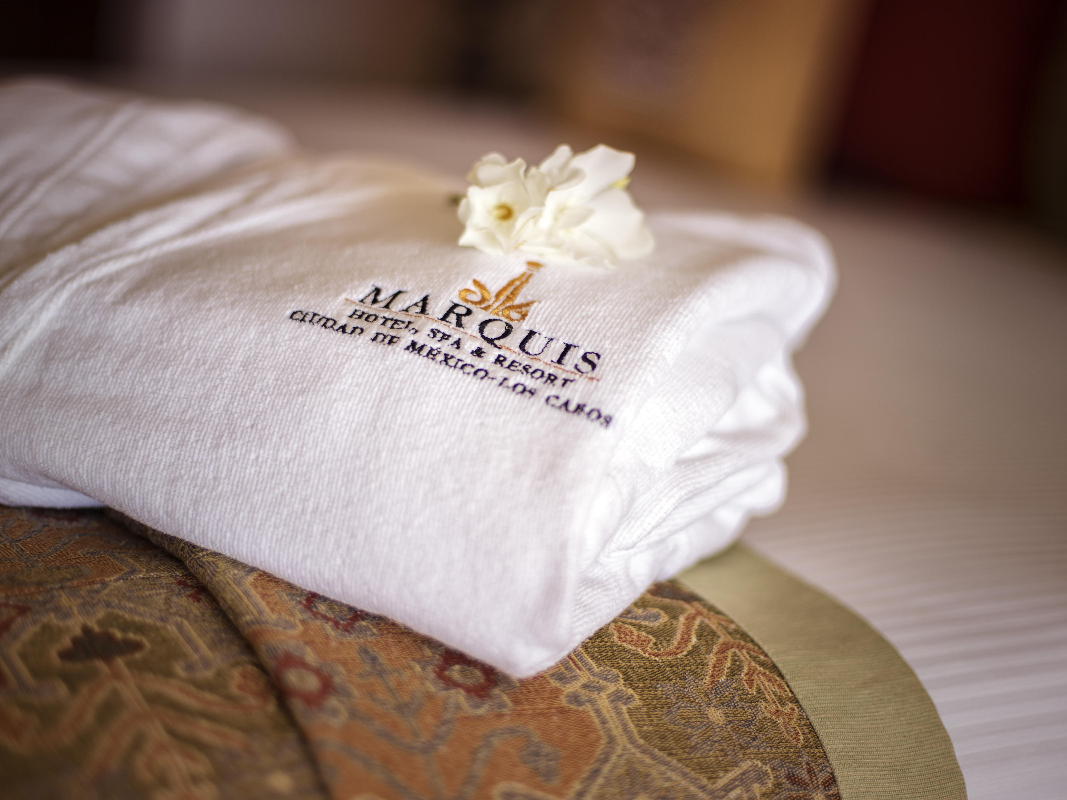 a bath robe on a hotel bed