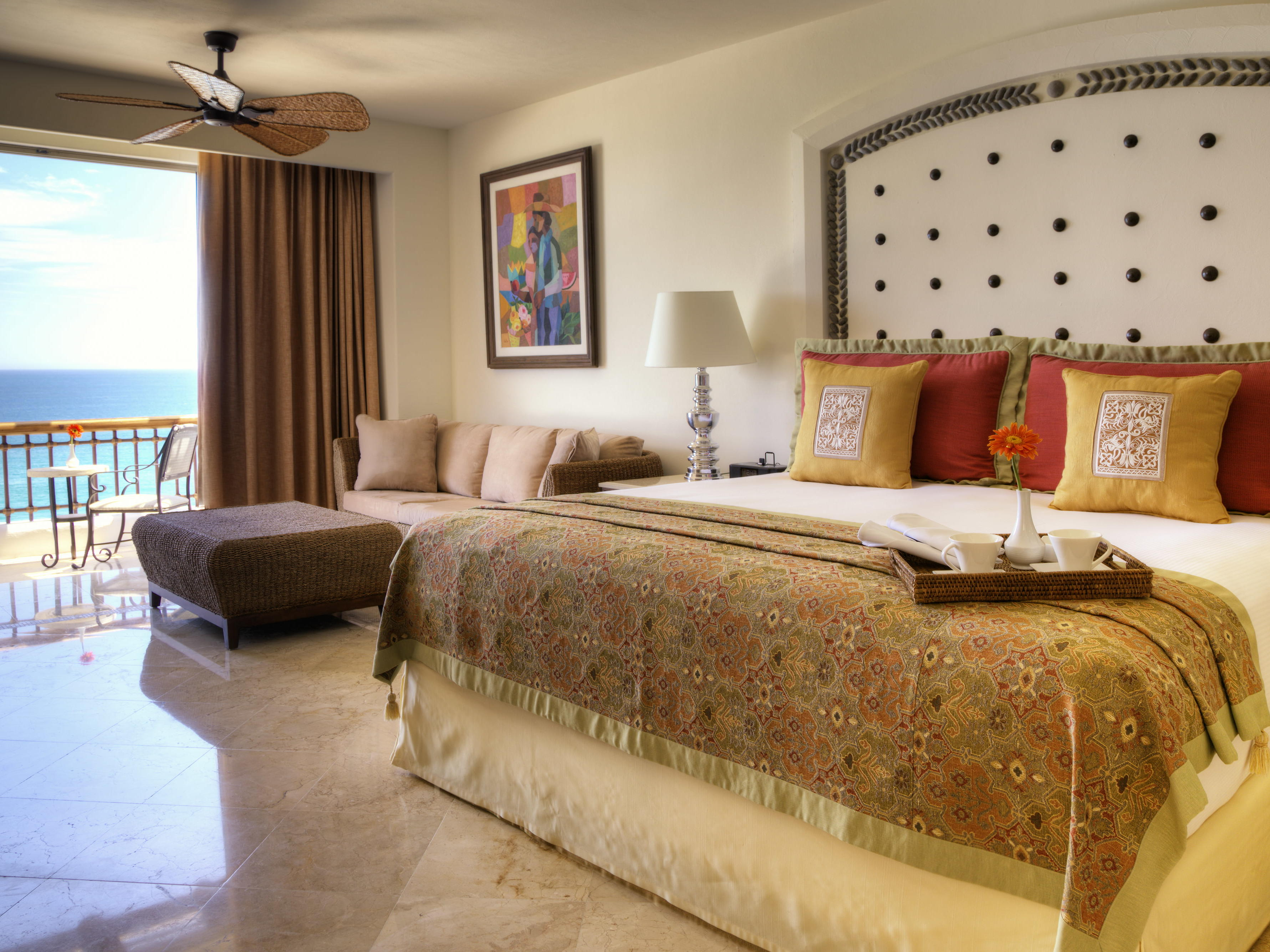 A bed and couch in a hotel room - Marquis Los Cabos