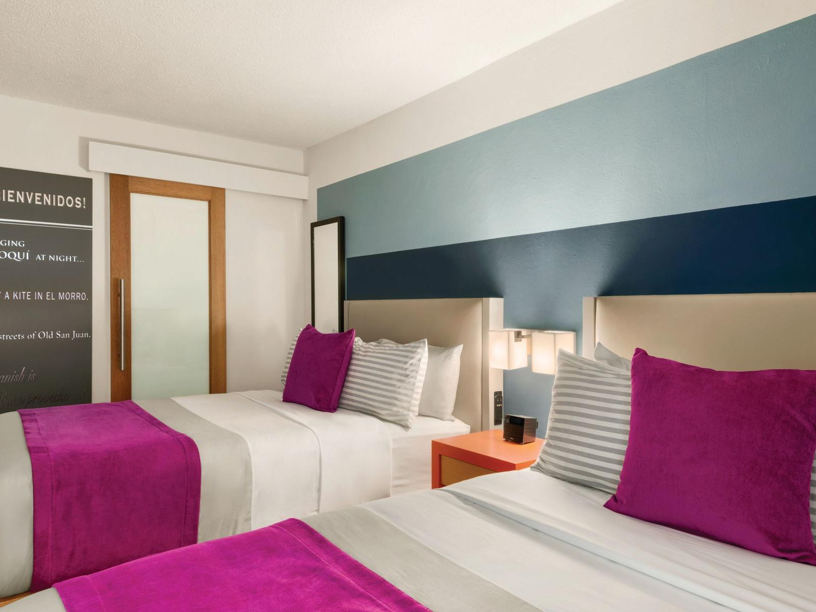 TRYP by Wyndham Isla Verde room with two beds with nightstand