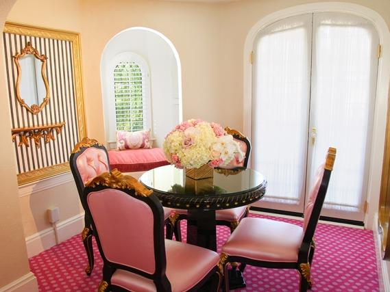 dining room with table and pink chairs