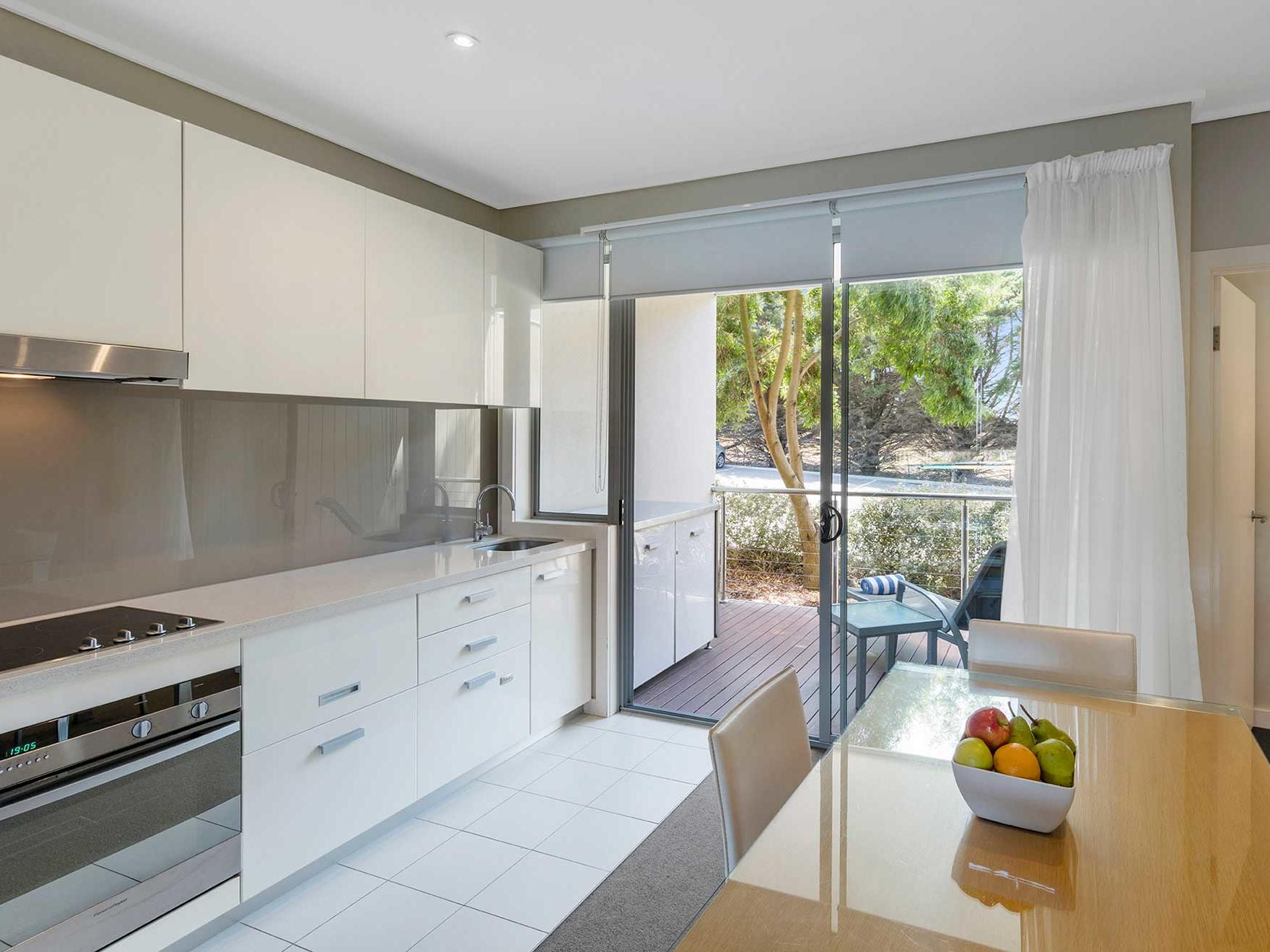 A chef's kitchen in 1 Bedroom Apartments at Silverwater Resort