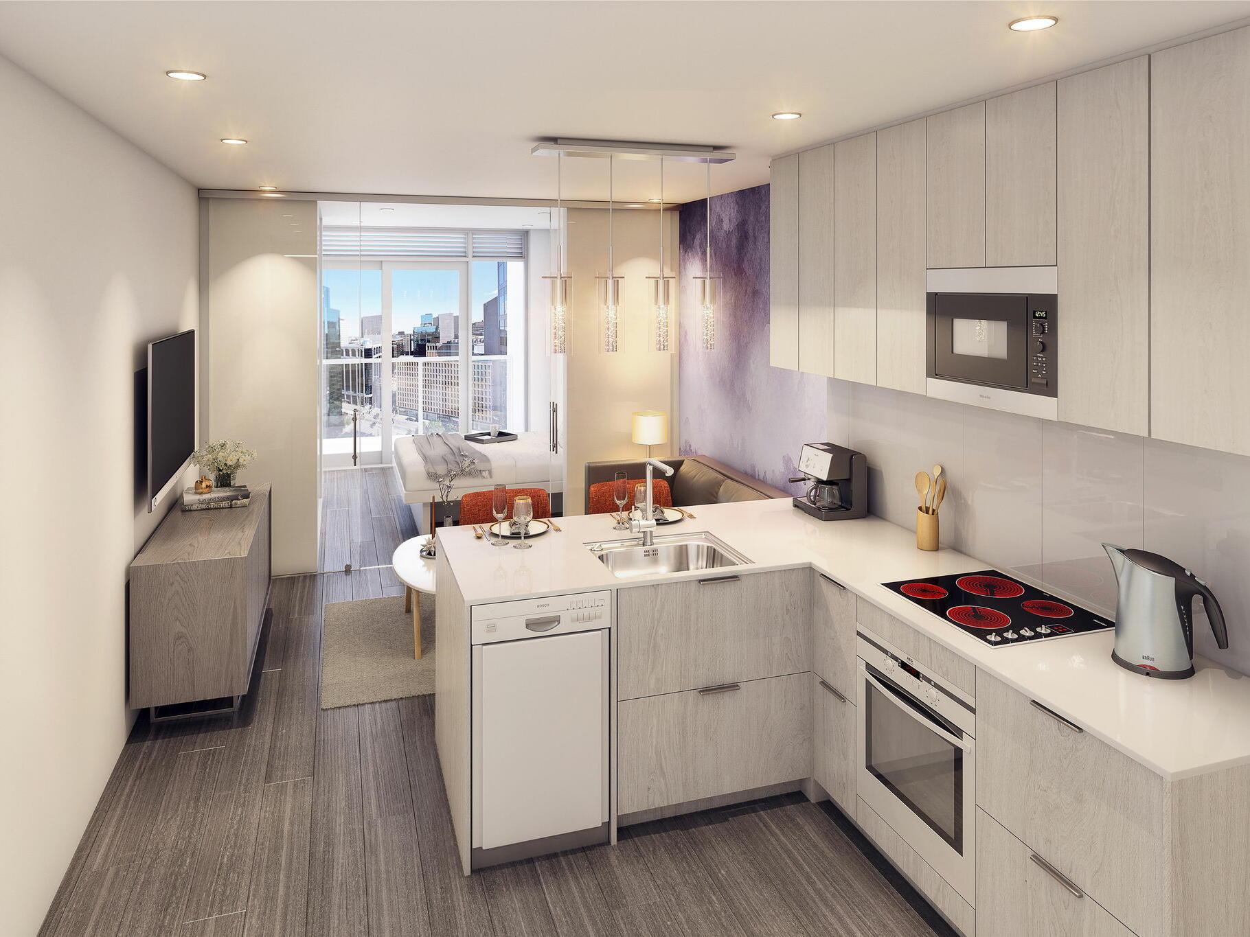 open kitchen with living room and door to bedroom