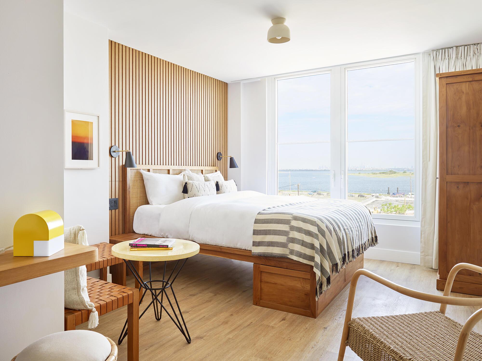 King bed in Bedroom in Deluxe King Bay at The Rockaway Hotel