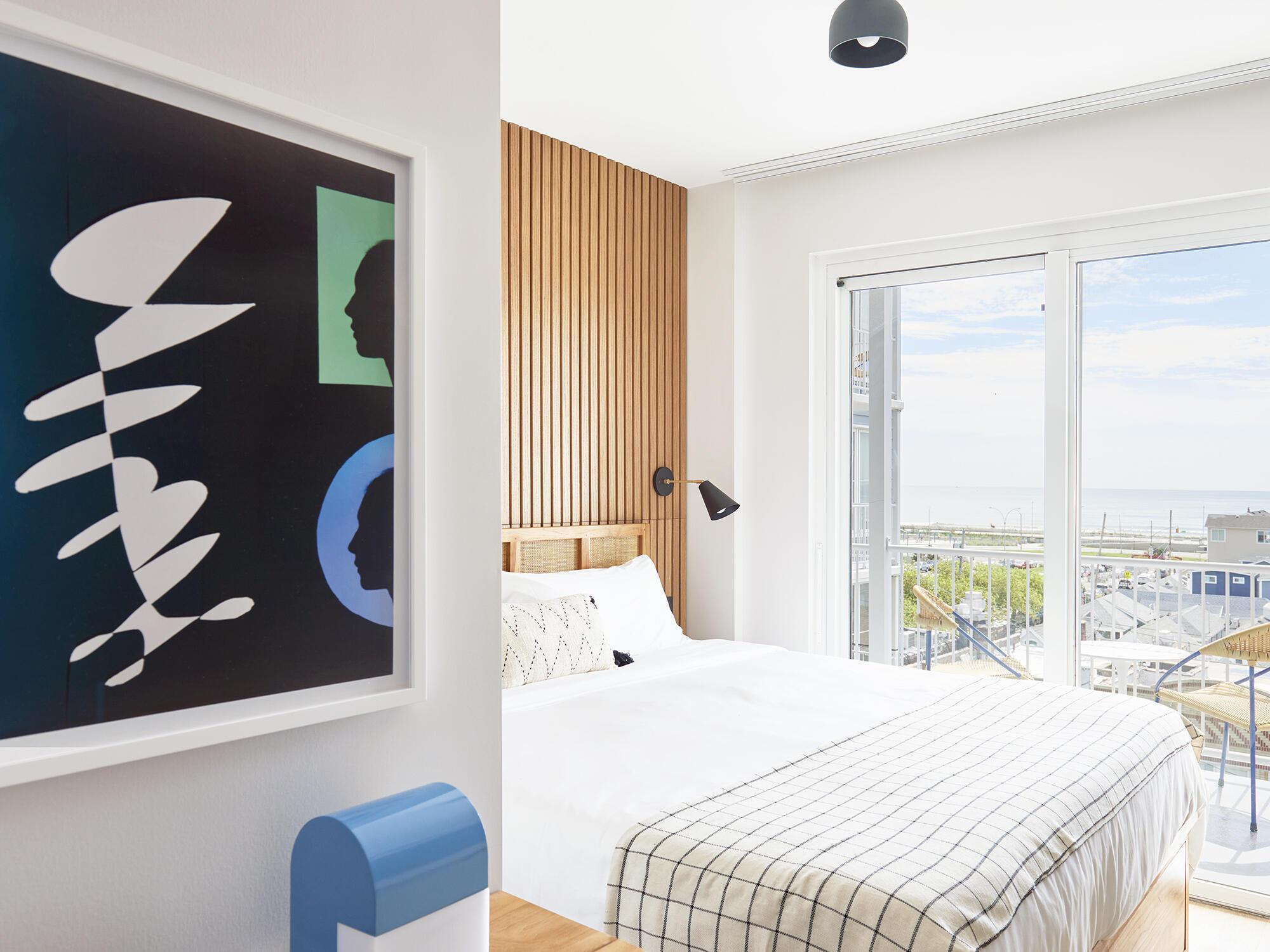King bed in Standard King Ocean View room at The Rockaway Hotel