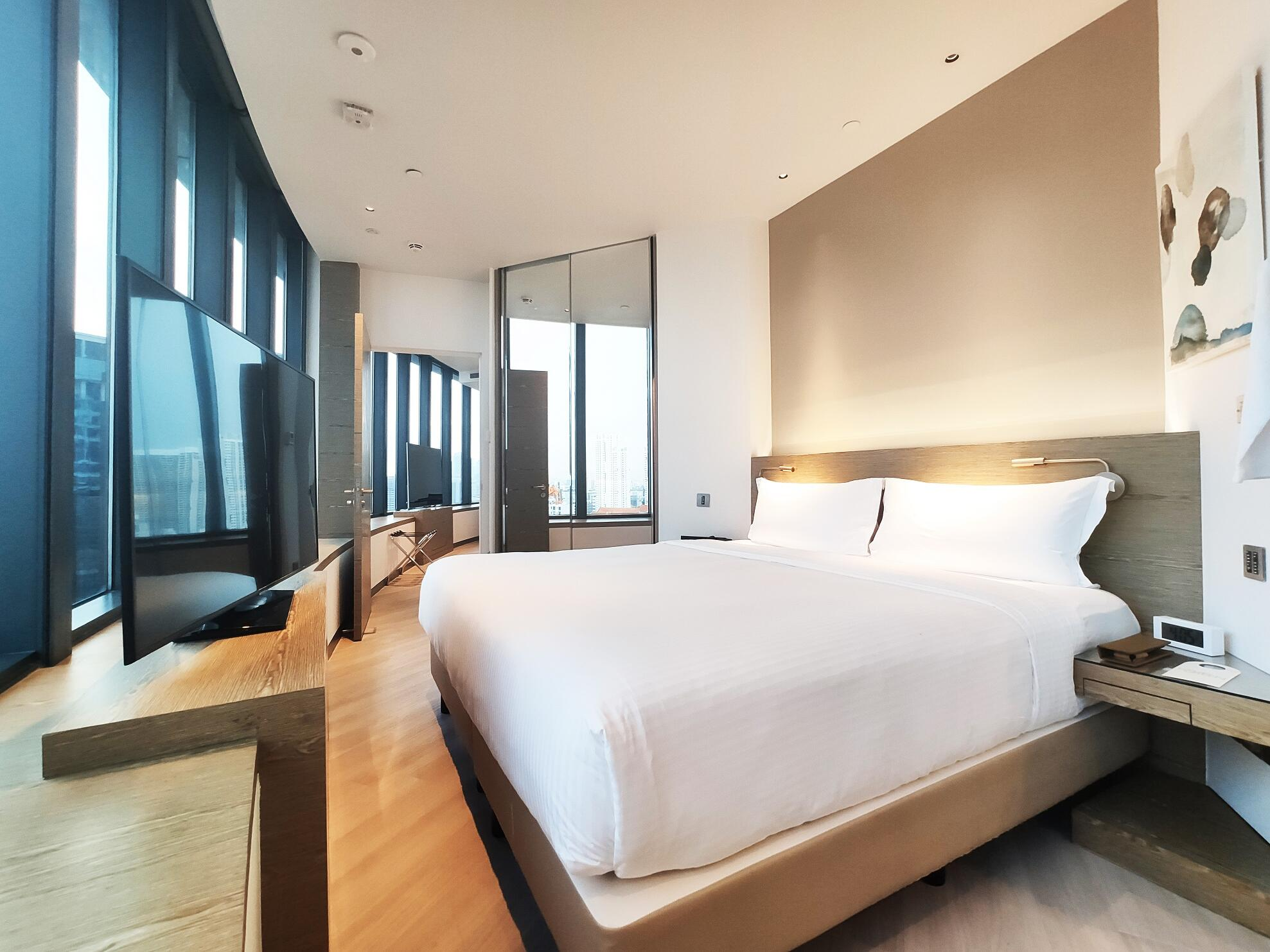 Interior of Skyline suite with a TV at one farrer hotel