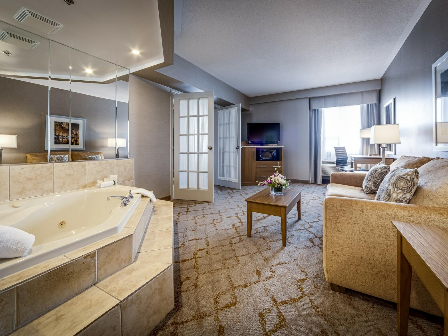 Deluxe King Jacuzzi Suite living room at Monte Carlo Inn Vaughan Suites