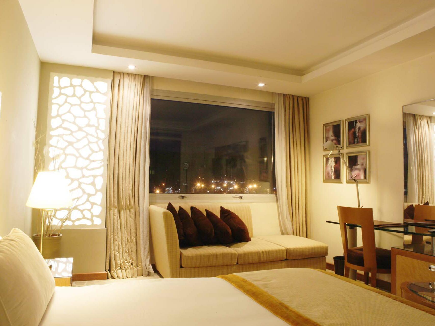 Bedroom with a large Window -  Farah Casablanca Hotel