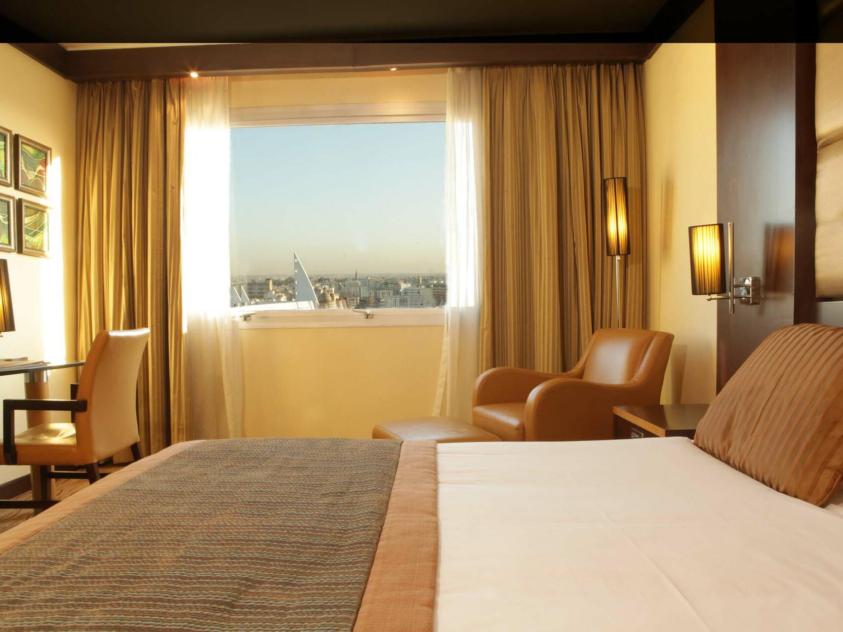 Large Bed with beautiful Window View - Farah Casablanca Hotel