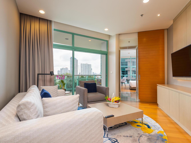 Living room in Premier one bedroom at Chatrium Residence Riverside Bangkok