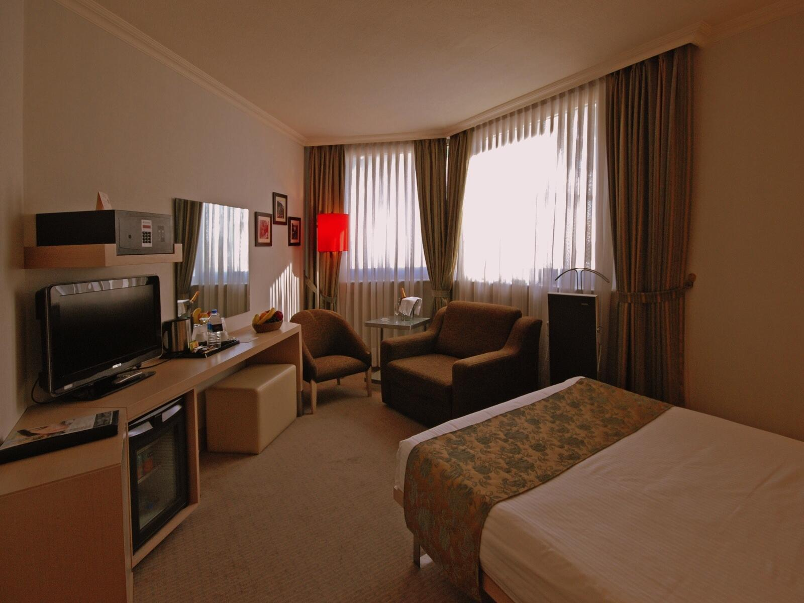 Bed room with a large television at Eresin taxim premier.
