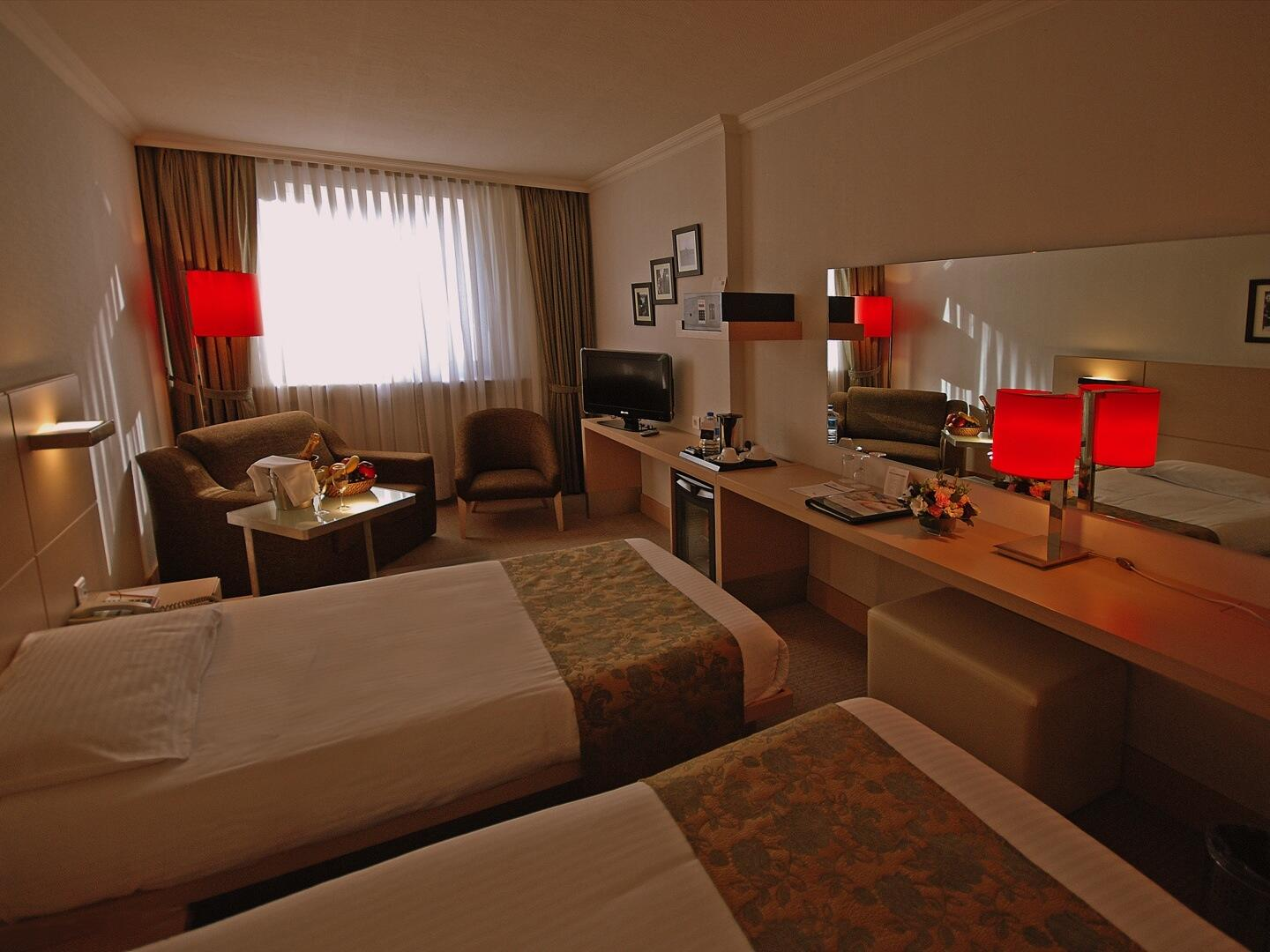 Bed room with a number of lamps at Eresin taxim premier.