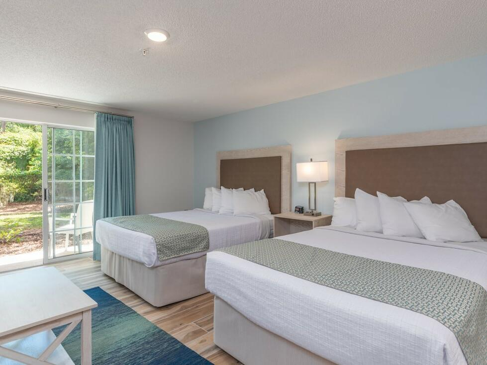 Two queen beds at Double Queen Suite at The Palmera Inn and Suites